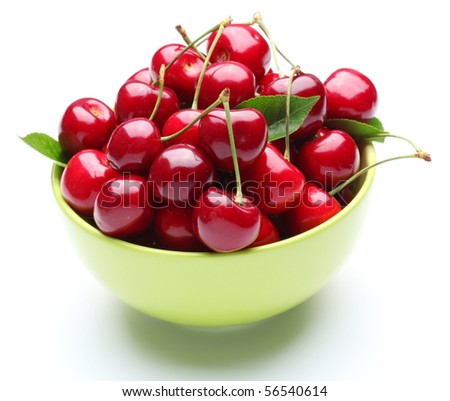 Crockery with ripe cherries. Isolated on a white background.