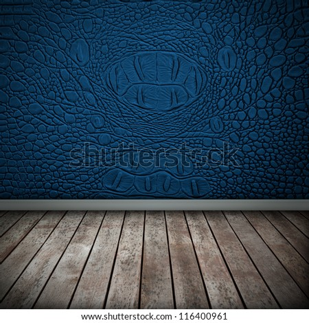 Crocodile blue wall with wood floor texture interior