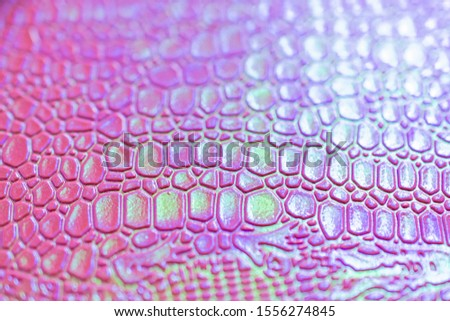Crocodile skin texture in neon colors. Trend concept 2019 colors pink, mint, proton purple.
