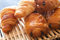 croissant and french chocolate bread on a table