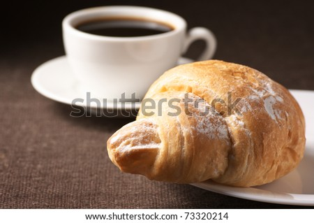 10.  Fatmagül'un sucu ne ? ~ General Discussions - Comentarii Stock-photo-croissant-and-white-cup-of-black-coffee-on-brown-canvas-73320214