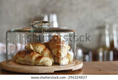 croissant in glass dessert jar at coffee shop
