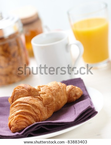 croissant on a napkin, shallow deep of field.
