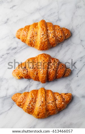 Croissants on marble table. French traditional pastry. Top view. #613466057