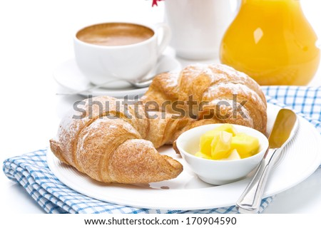 croissants with butter, espresso and orange juice for breakfast, horizontal