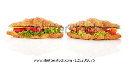 Croissants with cheese, salmon lettuce and tomatoes