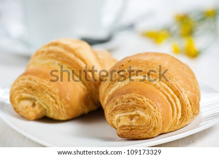 Croissants with cup of tea