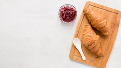 Croissants with marmalade - white Copy space