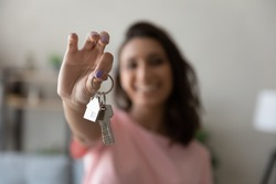 Crop close up of female tenant renter show praise house keys moving to first own new apartment or house, happy woman owner buy purchase home, relocate to dwelling, rental, rent, ownership concept