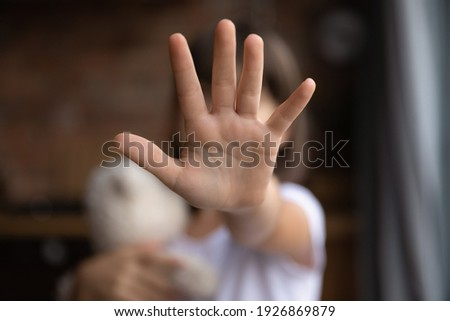 Crop close up of little girl child stretch hand show no gesture protest against domestic violence. Small teen child stand against discrimination or school abuse. Childhood problem, voice concept.