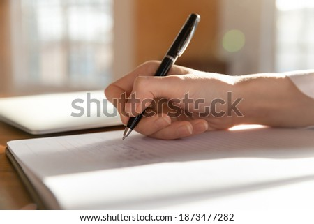 Crop close up of woman doctor or nurse write in medical journal patient illness history or anamnesis. Female GP or physician handwrite make notes fill clients form paper document. Healthcare concept.