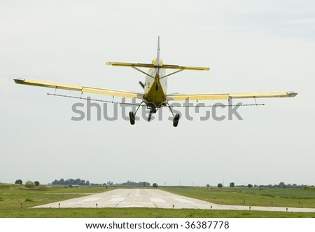 Crop duster prepares to land