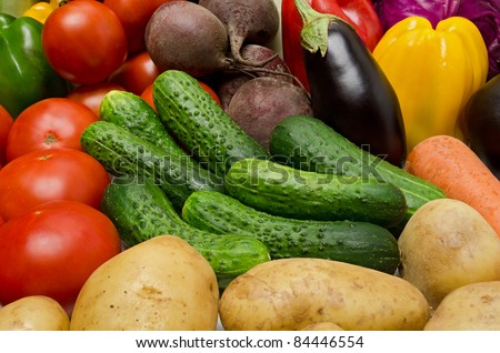 Crop of vegetables. Potatoes, tomatoes, cucumber, peppers, eggplant and other vegetables.