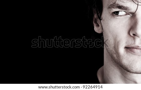 crop of young man's face looking at empty space