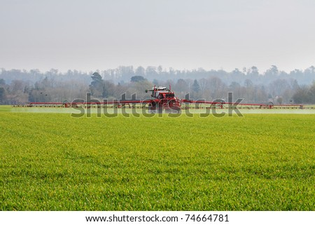 Crop spraying machine at work in an English field - stock photo