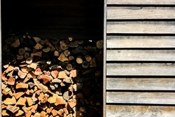 Crop surface a stack of firewood or fuelwood in the storage which made from wood in countryside of Australia
