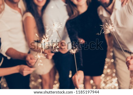 Cropped bengal fire sticks, sparkling, burning, elegant classy ladies and gentlemen's hands holding fire-sticks together, meeting, team, greetings, congrats #1185197944