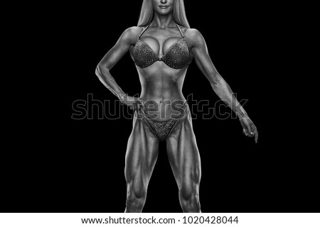 Cropped black white photo Fitness bikini model well trained body Sports competition female champion stage Athlete bodybuilder posing Perfect strong body trained shape arms abs chest legs Clipping path