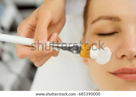 Cropped close up of a beautician applying facial mask on a young female face client service treatment therapy therapist dermatology cosmetology refreshing pampering wellness spa recreation skincare #685390000