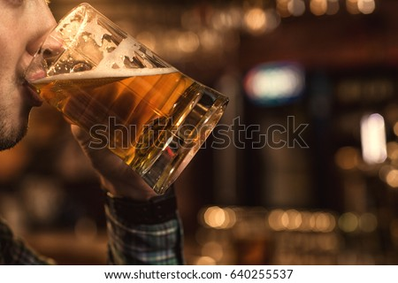 Cropped close up of a man drinking beer at the bar copyspace beverage brewery brewing delicious thirst thirsty sipping relaxing alcohol drink party event celebrate cool tasty leisure weekend concept #640255537