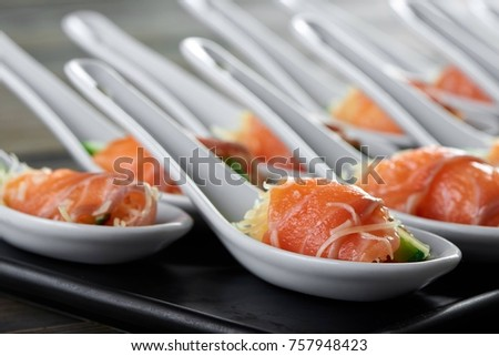 Cropped close up of smoked salmon rolls with delicious cheese filling inside served at the local restaurant copyspace serving portion nutrition fish seafood eating food cafe menu. #757948423