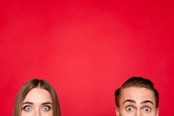 Cropped close-up of two faces nice attractive charming cheerful positive people staring eyes copyspace isolated over bright vivid shine red background