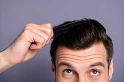 Cropped close up photo amazing he him his macho hands arms plastic hair styling brush take care hairdo barber shop stylist visit look up process experiment wear white t-shirt isolated grey background