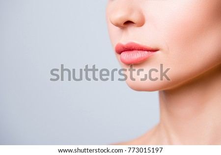 Cropped close up photo of beautiful woman's lips with shape correction, isolated on grey background, copyspace #773015197