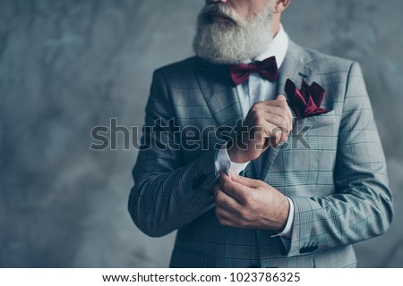 Cropped close up photo of chic virile luxurious trendy wealthy rich sharp well-dressed with burgundy accessories checkered jacket intelligent hipster grandpa fixing cuffs isolated on grey background