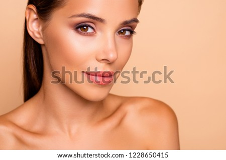 Cropped close up photo of dreamy cute well-groomed charming lady with her naked shoulders she stand half turn isolated on pastel beige background make nice smile