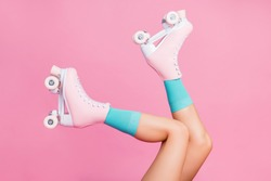 Cropped close-up profile side view of nice attractive lovely perfect feminine long legs wearing blue socks skates skating walking in air isolated over pink pastel color background