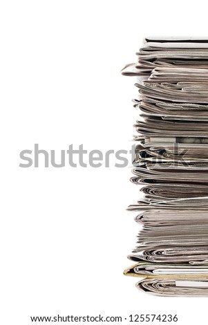 Cropped image of a pile of old newspaper displayed on white background for recycling.
