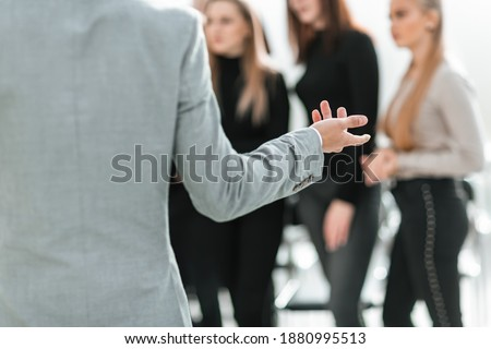 cropped image of a speaker making a presentation at a seminar. stock photo