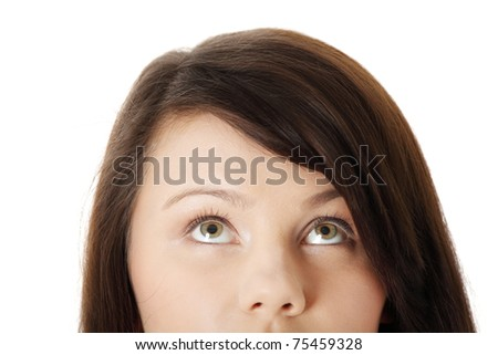 Cropped image of a young girl with her eyes looking up, isolated on white background