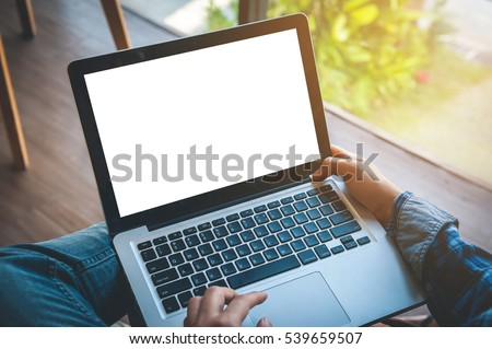 Cropped image of a young man working on his laptop in a coffee shop, rear view of business man hands busy using laptop at office desk, typing on computer sitting at wooden table #539659507