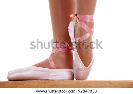 Cropped image of ballerina's feet in pointes