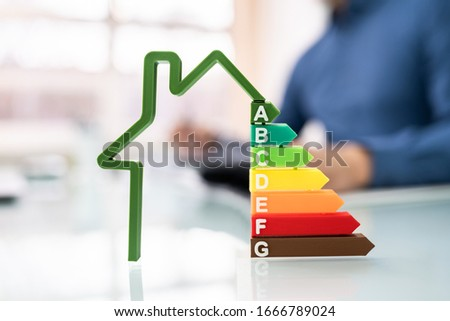 Cropped Image Of Businessman Calculating Energy Efficiency Rate In Office Foto stock ©