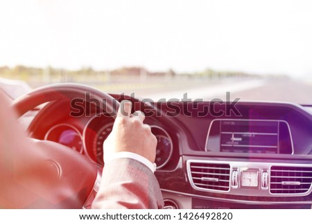 Cropped image of businessman in formals driving car #1426492820