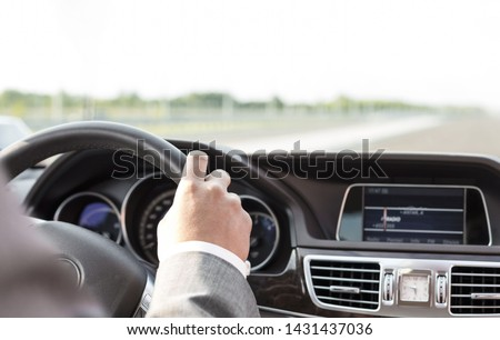 Cropped image of businessman in formals driving car #1431437036