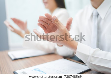 Cropped image of businesspeople clapping. #730748569