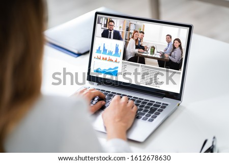 Cropped Image Of Businesswoman Using Laptop At Desk