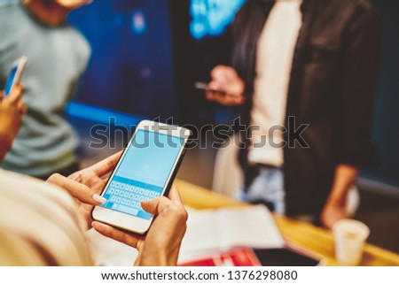 Cropped image of female holding mobile phone with blank monitor sending text message via new application for chatting, millennial generation woman using modern smartphone connected to 4G internet