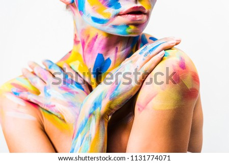 cropped image of girl with colorful bright body art touching shoulders isolated on white  #1131774071