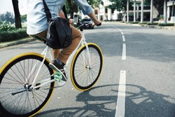 Cropped image of guy cycling in the city
