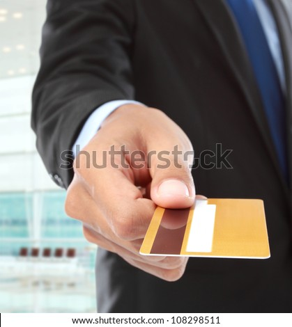 cropped image of hands paying using credit card