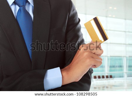 cropped image of hands with credit card