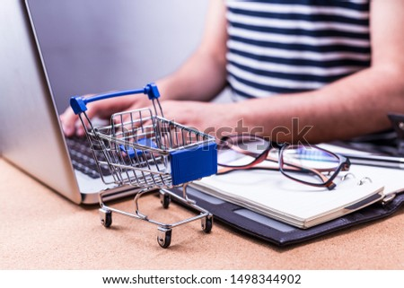 Cropped image of man working with his laptop. digital online shopping business
