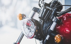 Cropped image of new motorcycle in shop. Motorcycles and accessories in modern motorcycle custom store. Biker stuff
