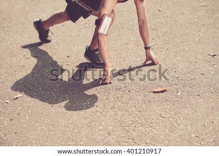 Cropped image of runner in starting position #401210917