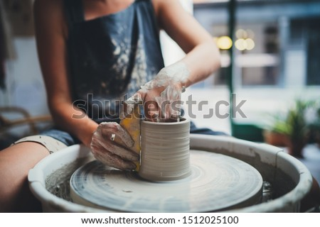 Cropped Image of Unrecognizable Female Ceramics Maker working with Pottery Wheel in Cozy Workshop Makes a Future Vase or Mug, Creative People Handcraft Pottery Class  Сток-фото ©